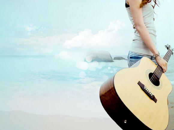 女孩手拿吉他海边ppt背景图片